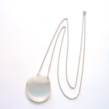 Magnifying lens on silver chain necklace