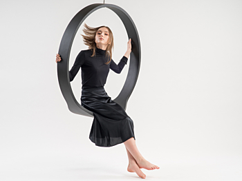 Swing model n.1 acts as a contemporary rocking chair